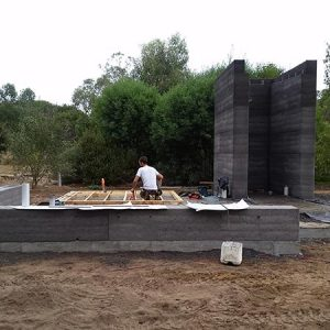 Rammed earth walls take shape at this Balnarring project