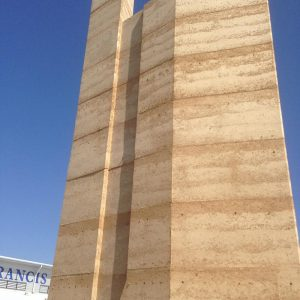 Rammed earth wall by Olnee
