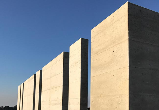 Take a look at the gallery of Olnee's rammed earth projects under construction