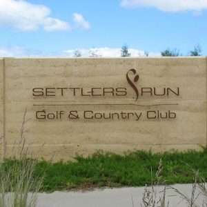 Rammed earth completed project - Settlers Run Golf Club