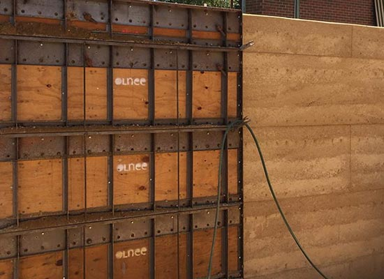 Take a look at our rammed earth process page