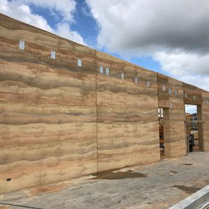 Livingston Childcare Centre rammed earth walls by Olnee